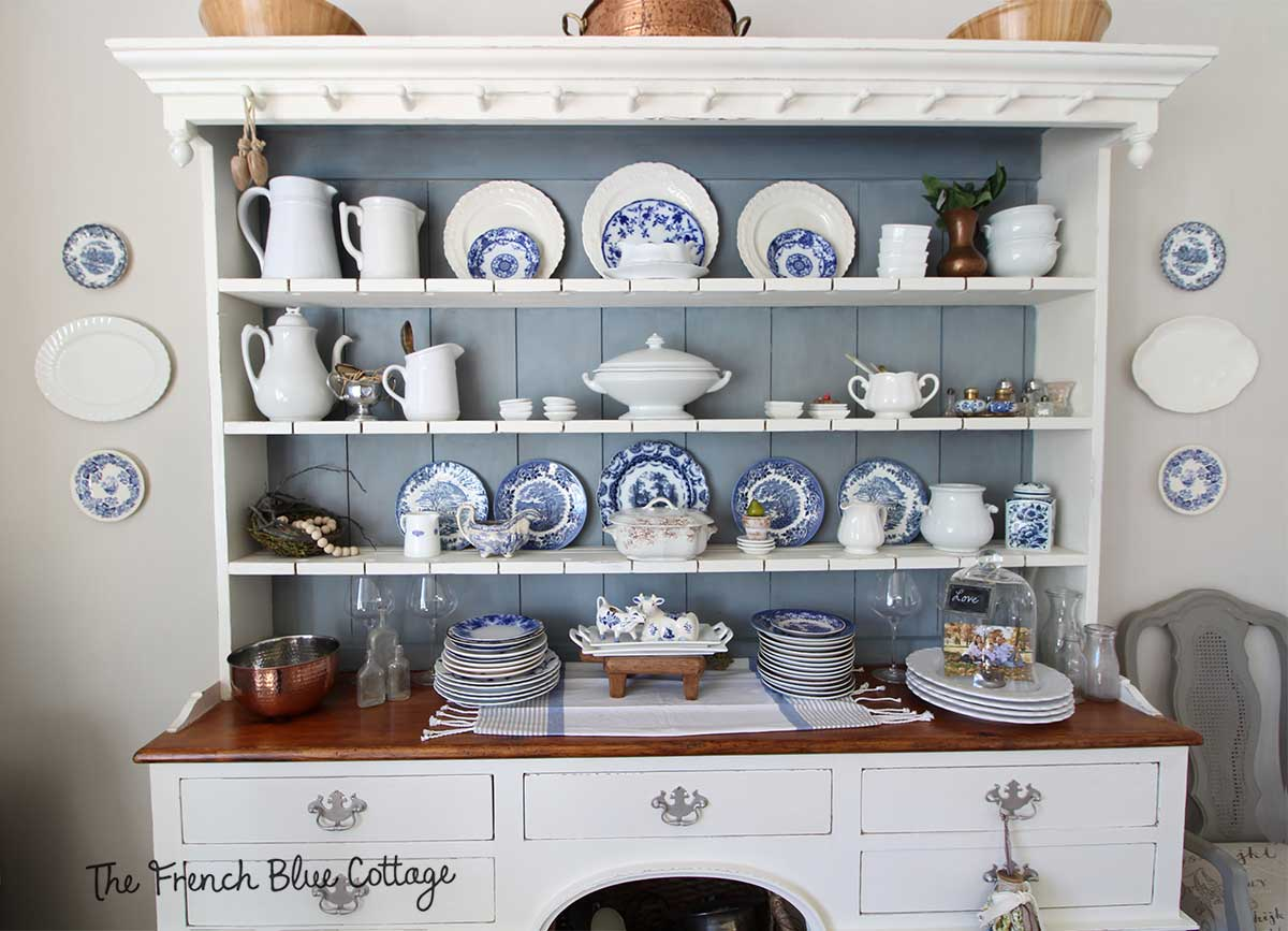 Welsh cupboard china cabinet with blue and white plates.