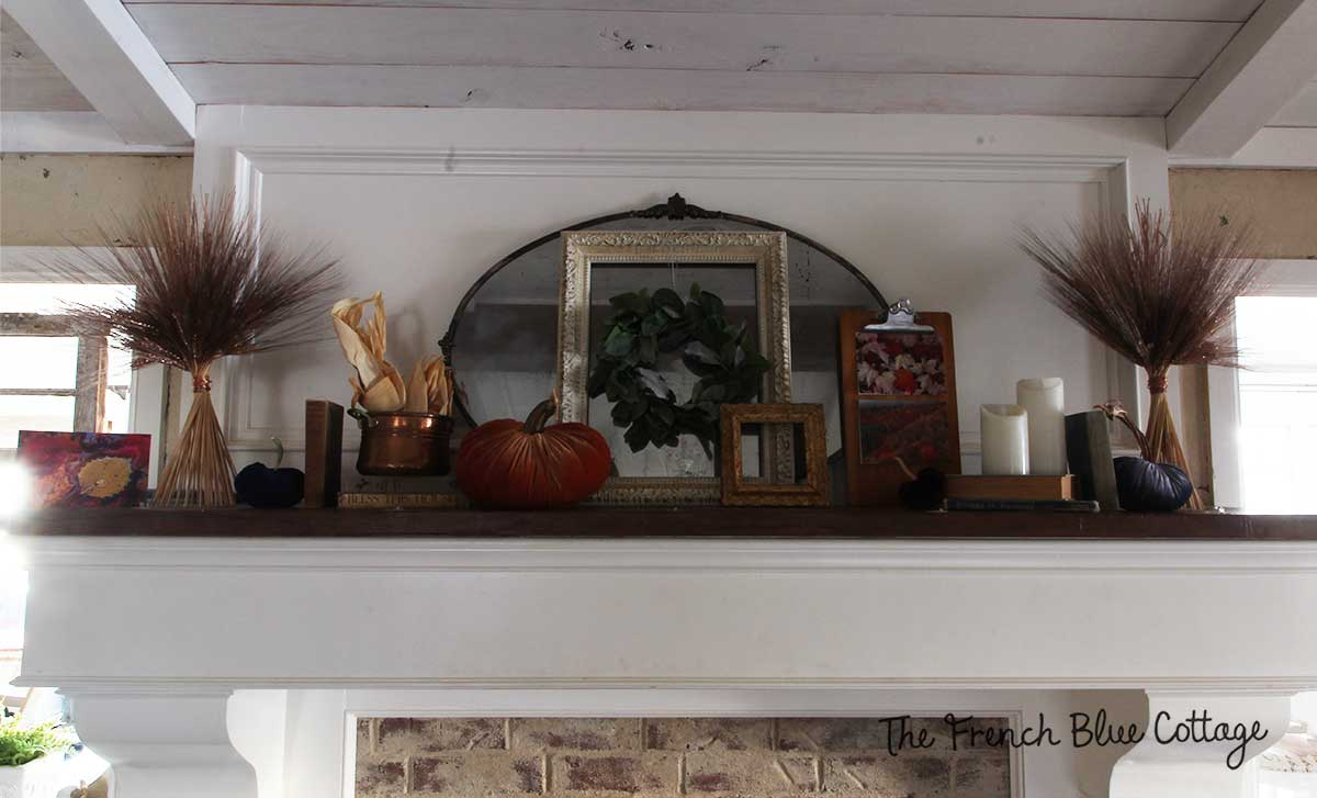 Fall mantel with copper wheat bundles.