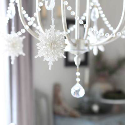 Glittery snowflakes on a chandelier for Christmas.