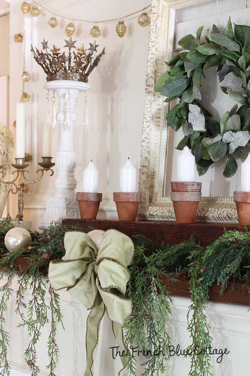 French country mantel with clay pot candles.