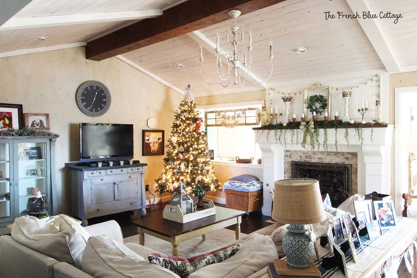 A French country living room decorated for Christmas.