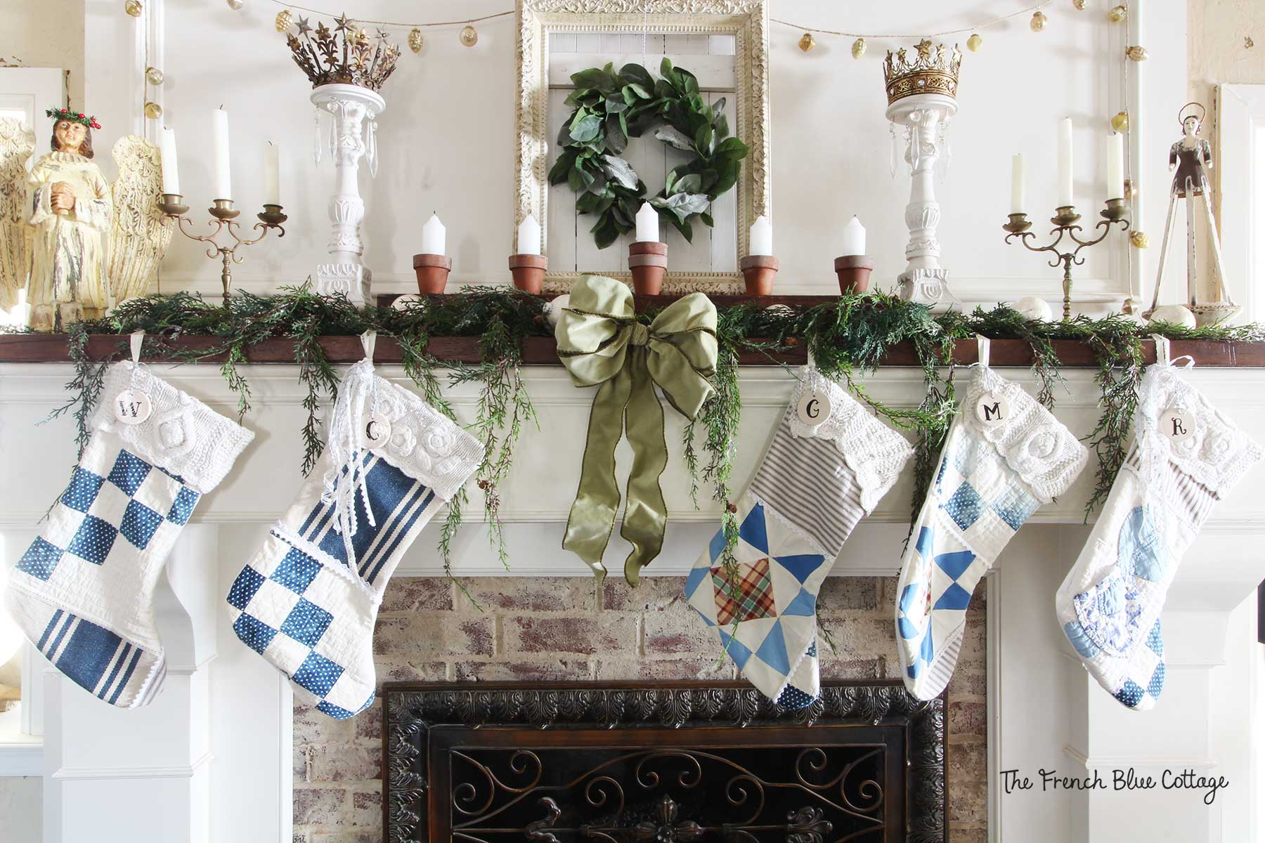Patchwork stockings on a French country Christmas mantel.