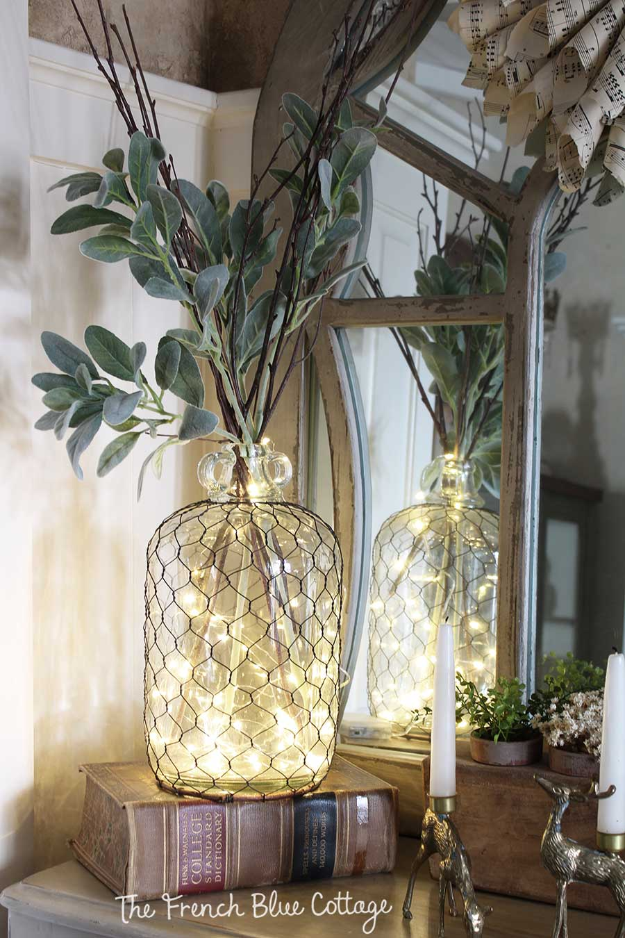 Winter vignette with fairy lights in a jar with remote.