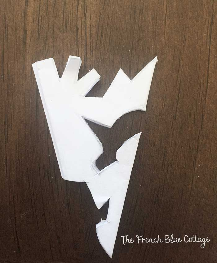 Paper snowflake with pattern cut out.
