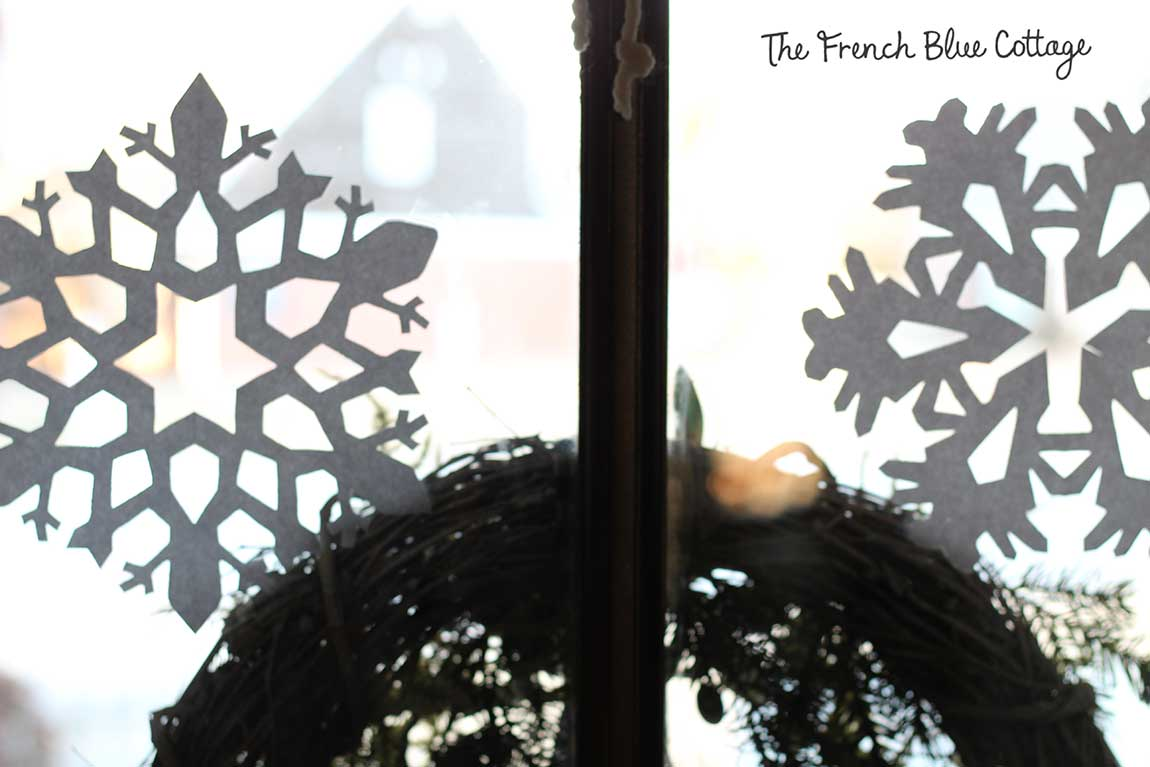 Patterned snowflakes on the front door.
