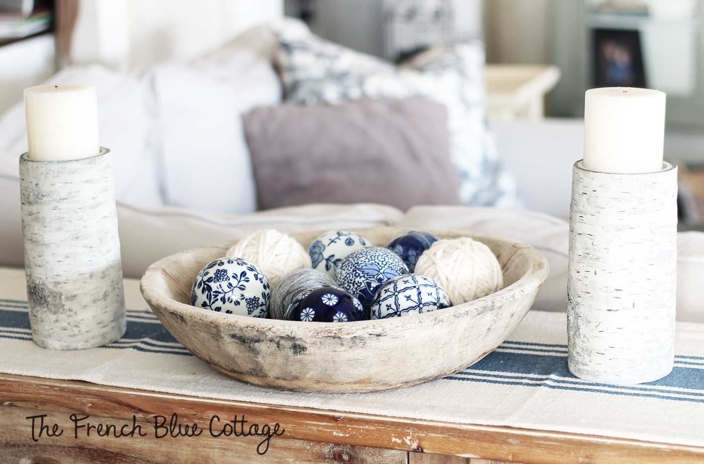 Textural winter vignette with yarn, birch, and blue ceramic.
