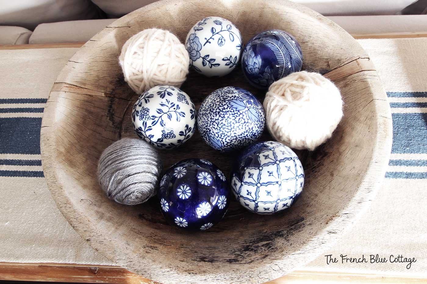 Yarn and ceramic balls in a rustic bowl.