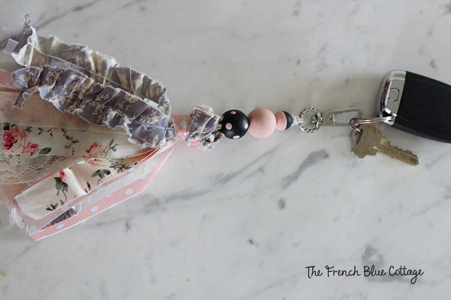 Wood beads and ribbon tassel keychain.