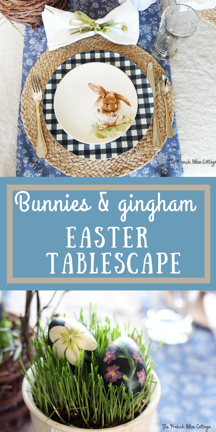 An Easter tablescape with bunnies, gingham, and real grass with painted eggs.