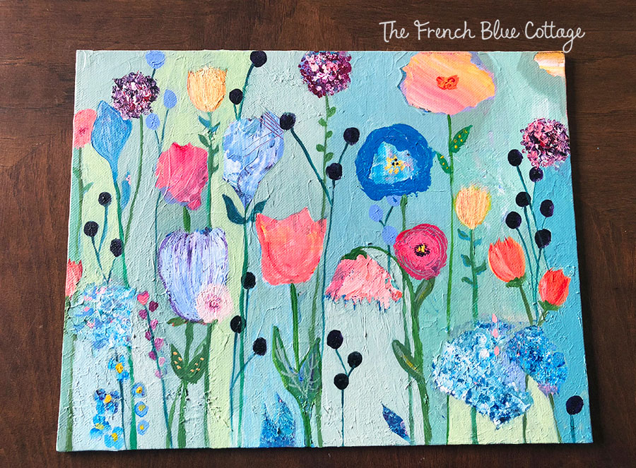 You can make a layered painting of flowers using acrylic paints.