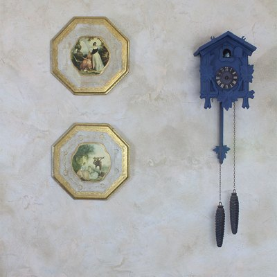 blue cuckoo clock and plaques