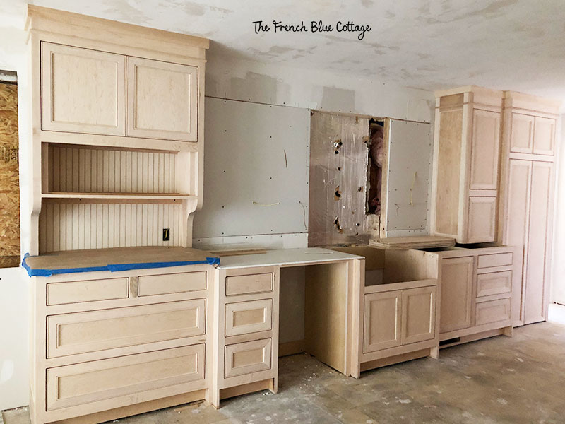 bare wood cabinets in a kitchen remodel