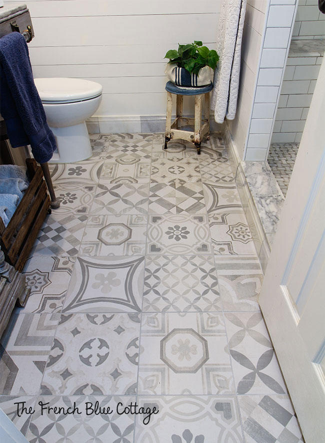 pathwork style tile floor in gray and white