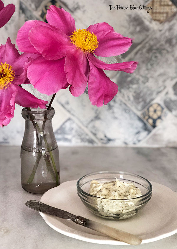 bowl of herb butter and vase of peonies