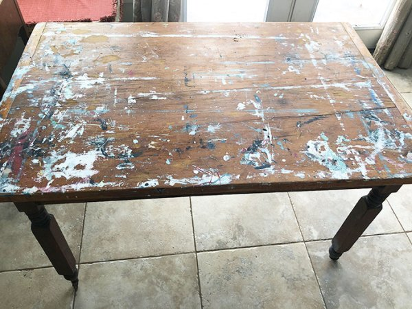 old pine table with paint all over the top