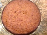 The golden cake coming out of the oven