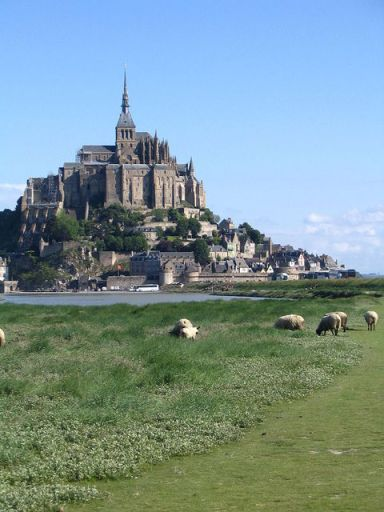 Mont St. Michel with the famous sheeps the-mount-with-its-©-Janet13-Licence-[CC BY 2.5]-from-Wikimedia-Commons