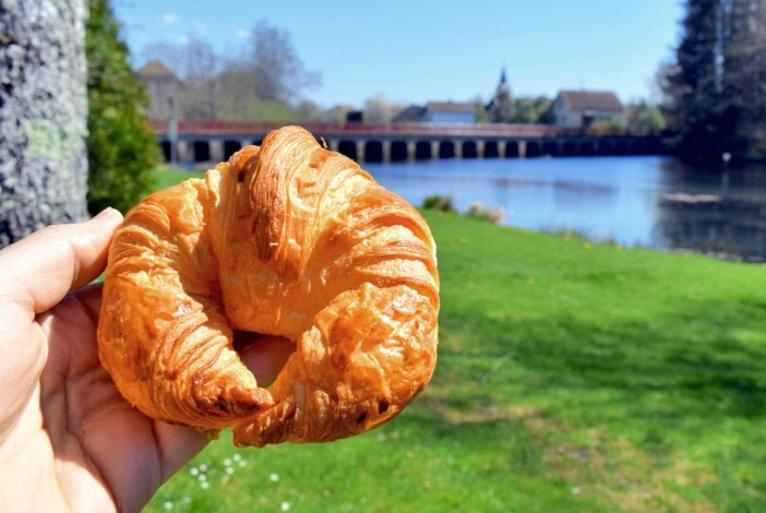 About to eat a French croissant near Lure (Haute-Saône) © French Moments