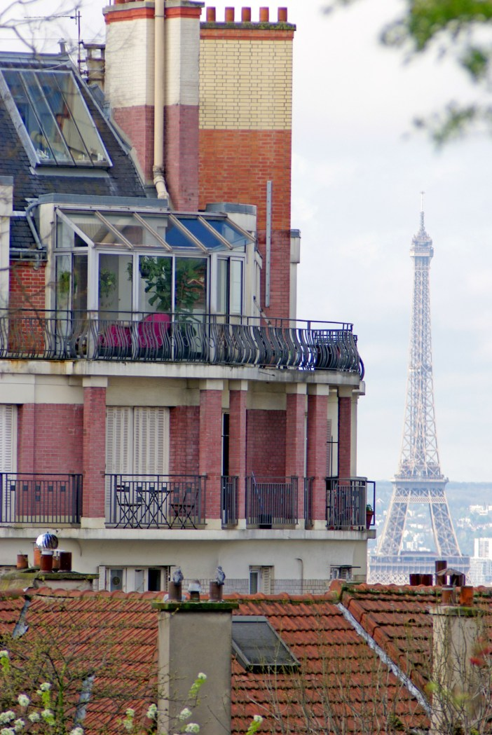 The Eiffel Tower seen from the rue Norvins, Montmartre © French Moments