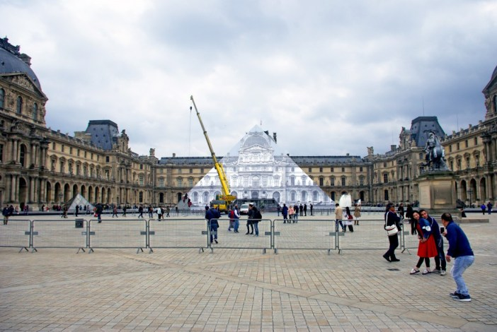 The right place at the right angle to see the 'invisible' pyramid of the Louvre by JR © French Moments