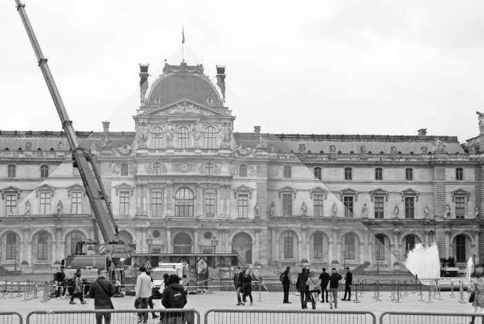 The installation of JR's work onto the glass Pyramid of the Louvre is nearly completed - the optical illusion creates a perfect stunt! © French Moments