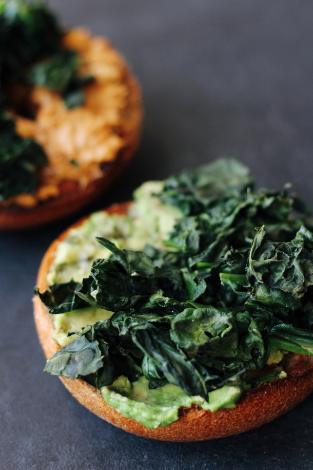 Crispy Kale Sandwiches. An easy, #vegan and #vegetarian breakfast idea: layer crispy kale on top of salted avocado and peanut butter.