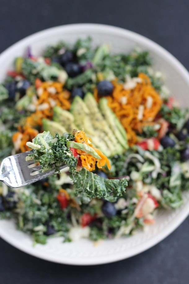 A simple kale and raw veggie salad with a creamy maple tahini dressing. Vegan, gluten free and flexible for ingredients you have on hand!