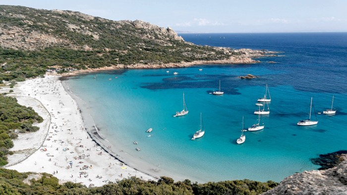 Beach with sailing yachts in Propriano, Corsica