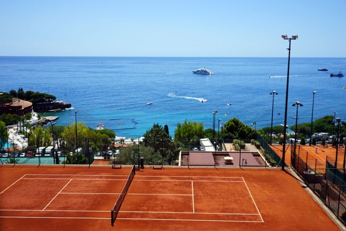 Monte-Carlo Country Club tennis courts view of sea and yachts
