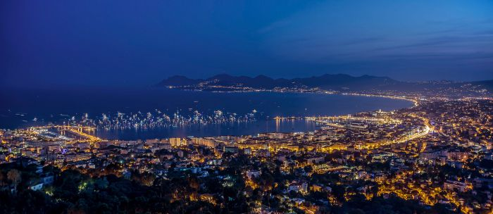 Night panorama of the bay of Cannes with luxury yachts