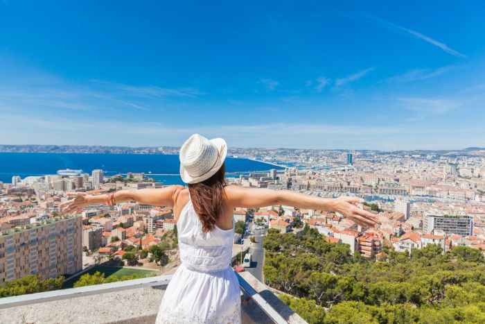 Girl enjoying panoramic view over Marseille, France