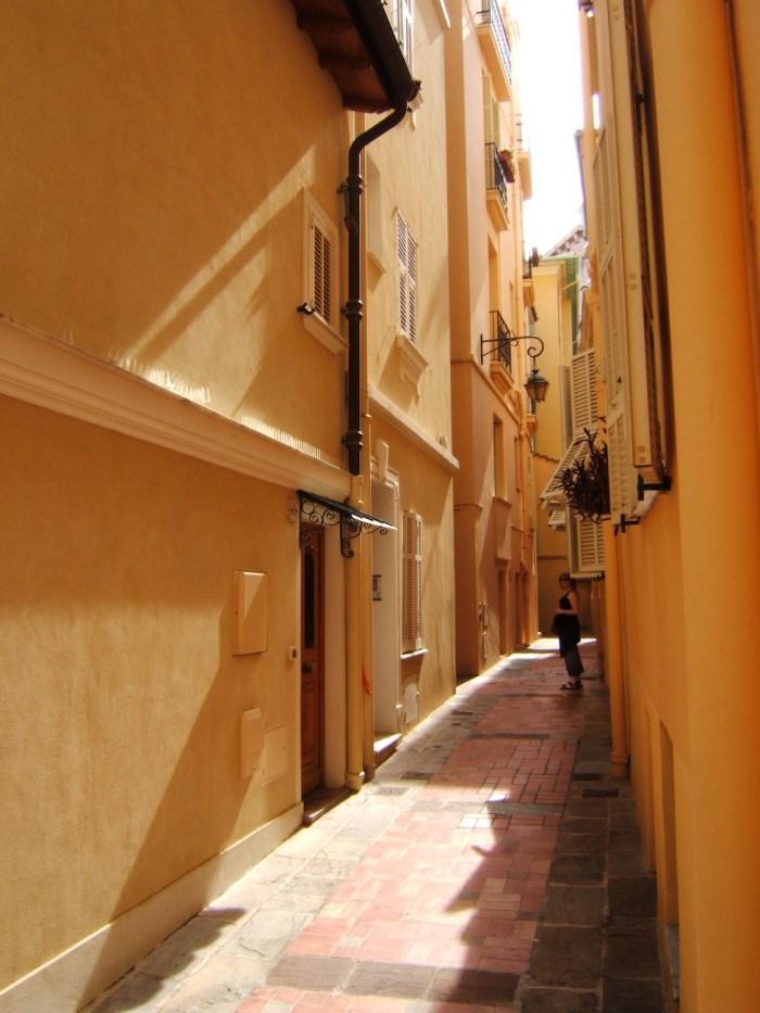 Old houses in narrow street in Monaco