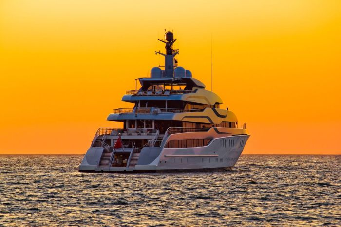 Luxurious superyacht at sunrise in the Mediterranean