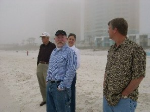 Family on the Beach in Panama City, Florida on a foggy day in January