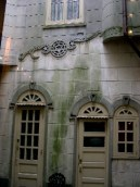 The Back Courtyard: My photoblog of New Orleans starts out with architecture, which turned into my focus for the entire time I was there. The photo above shows a hidden courtyard that was tucked away in the back of a contemporary art gallery selling shaped mural fragment paintings by a contemporary artist.
