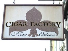 Perverted/Converted Fleur de Lis Graphic for a Cigar Store: The Cigar Factory sign features a fleur de lis formed by tobacco leaves. This was one of my favorite Fleur de Lis images. The absolute best one is one I missed however which was a fleur de lis made up of two staffs of wheat in the middle surrounded by two croissants.