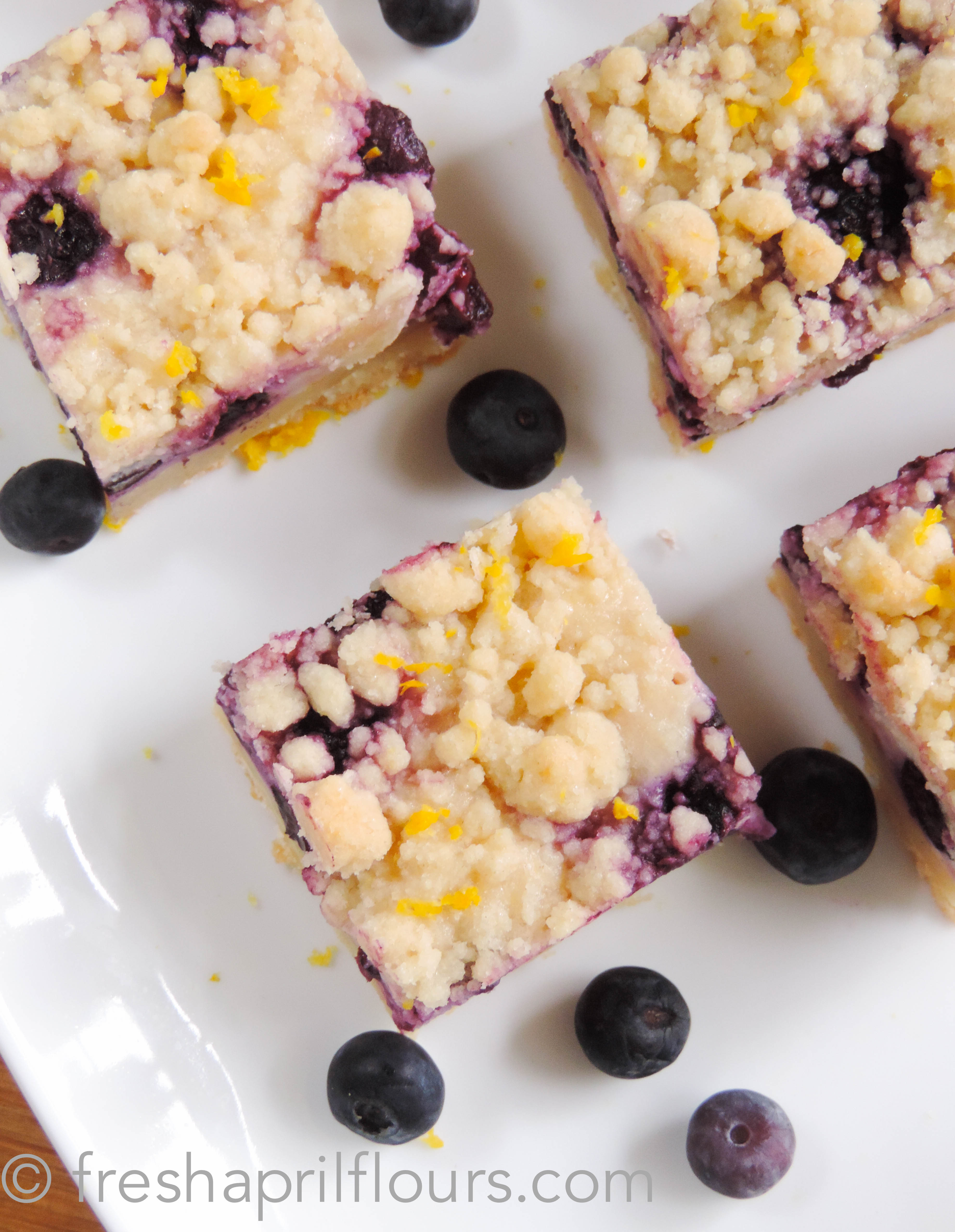aerial photo of blueberry lemon pie bars on a plate