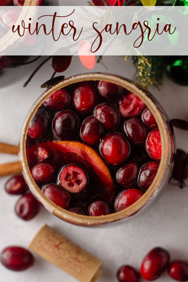 This spiced winter sangria is made with a mulled cranberry syrup, cinnamon and cloves, freshly squeezed orange juice, triple sec, and red wine.