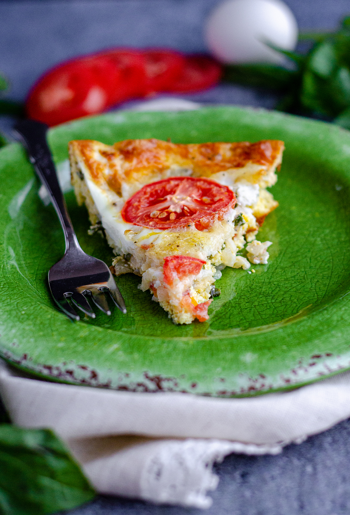 A crustless, low-carb quiche bursting with flavorful basil, creamy mozzarella, and juicy tomatoes.