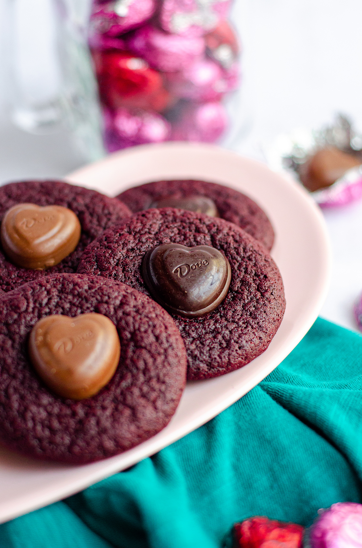 red velvet blossom cookies on a pink plate