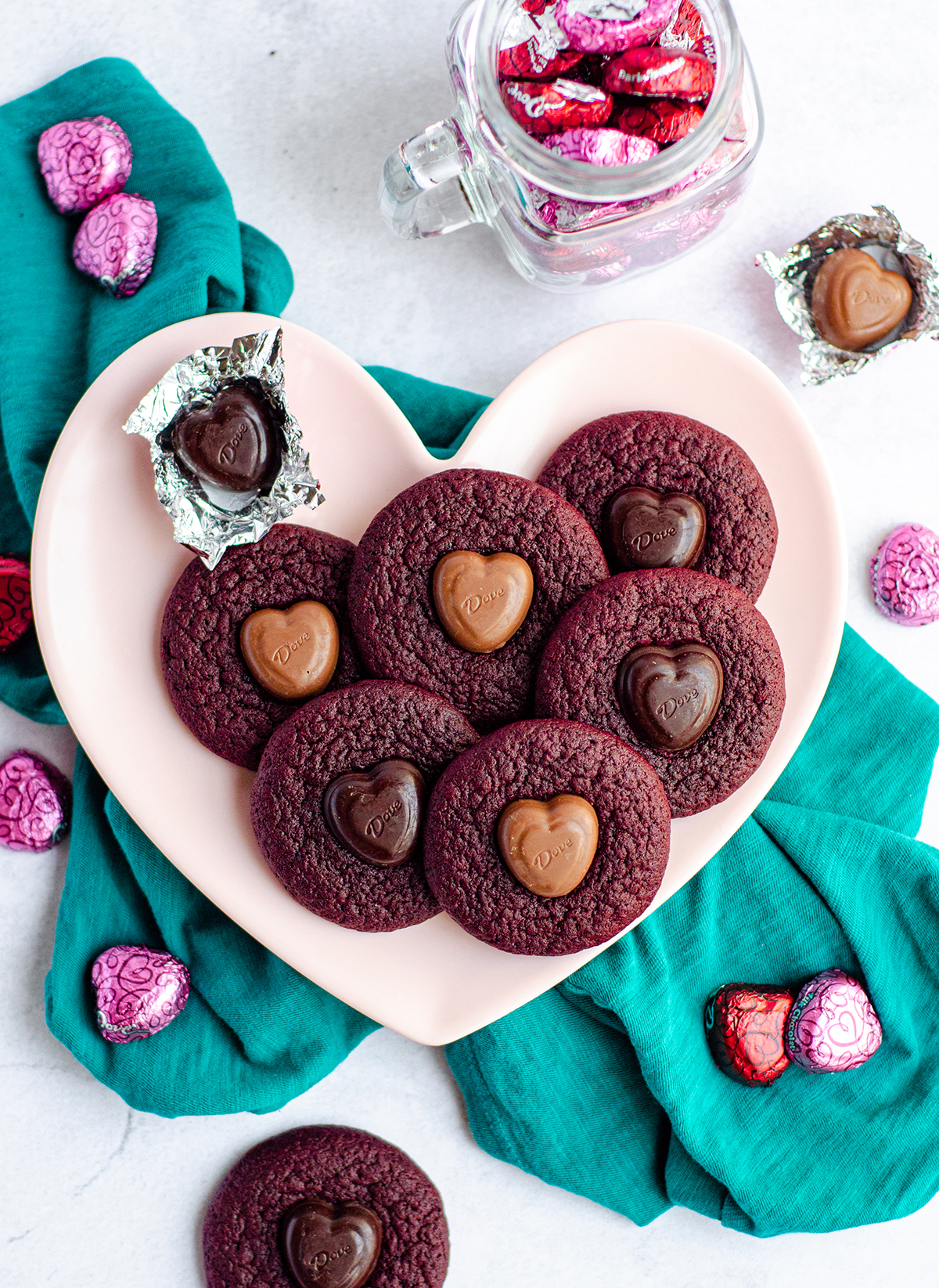 Soft and chewy red velvet cookies, topped with a chocolate heart. No box mix required-- they're made completely from scratch!