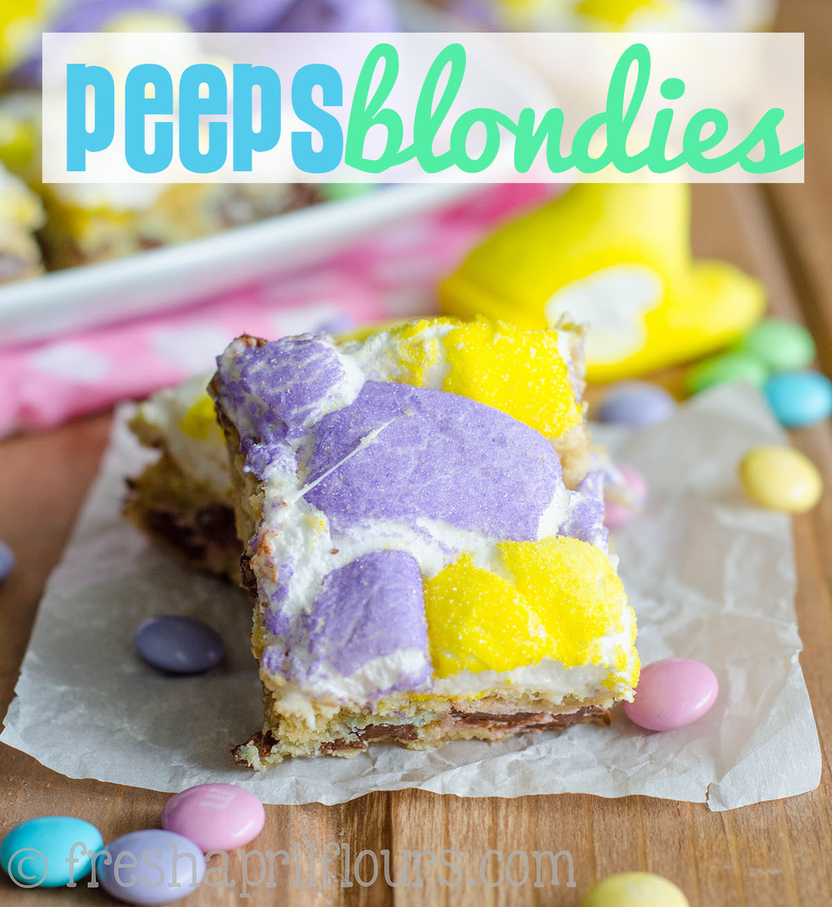 Peeps Blondies: Buttery, chewy blondies filled with milk chocolate m&m's and topped with gooey, melted Peeps. Perfect for Easter!