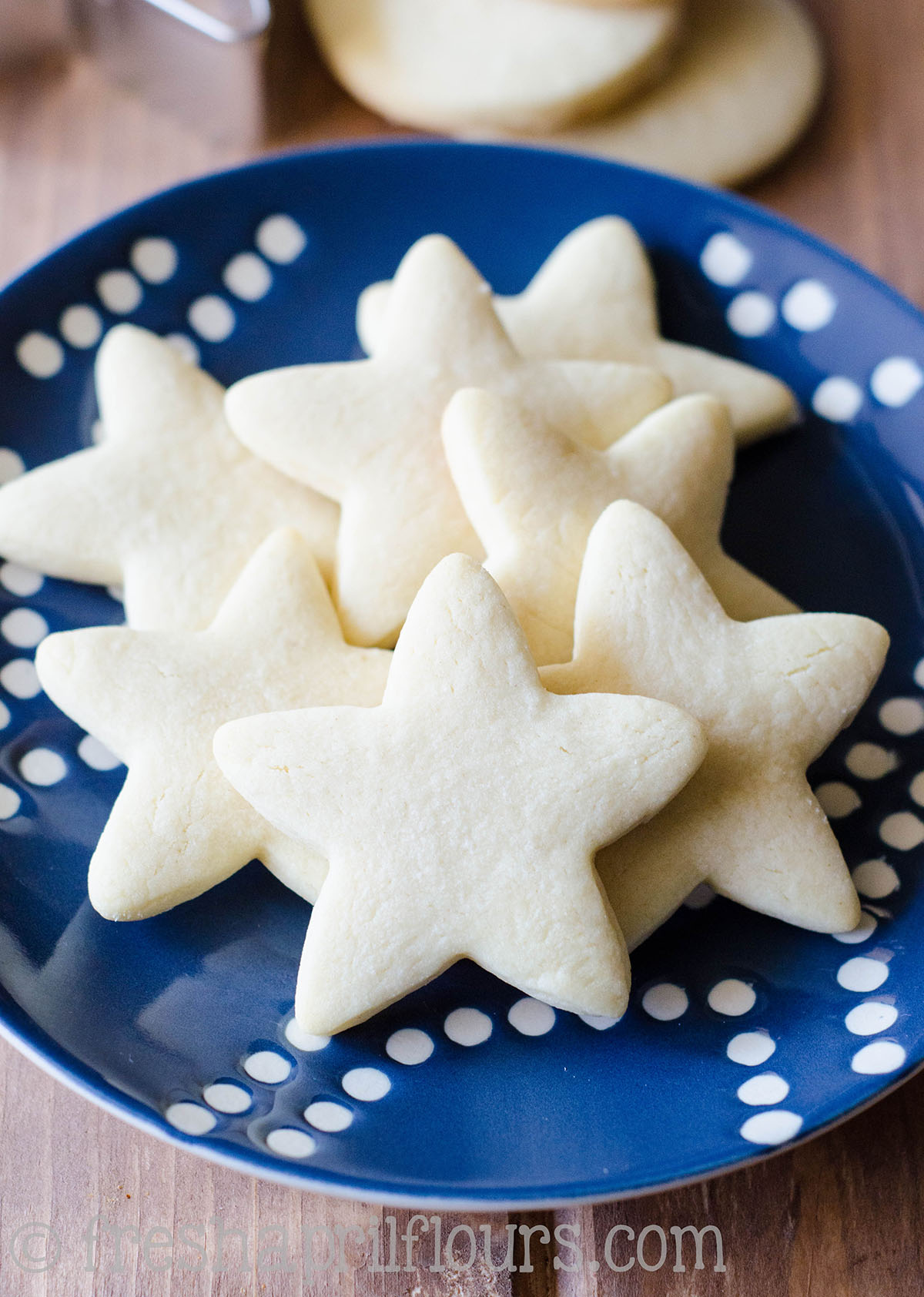 star shaped cut-out sugar cookies on a plate