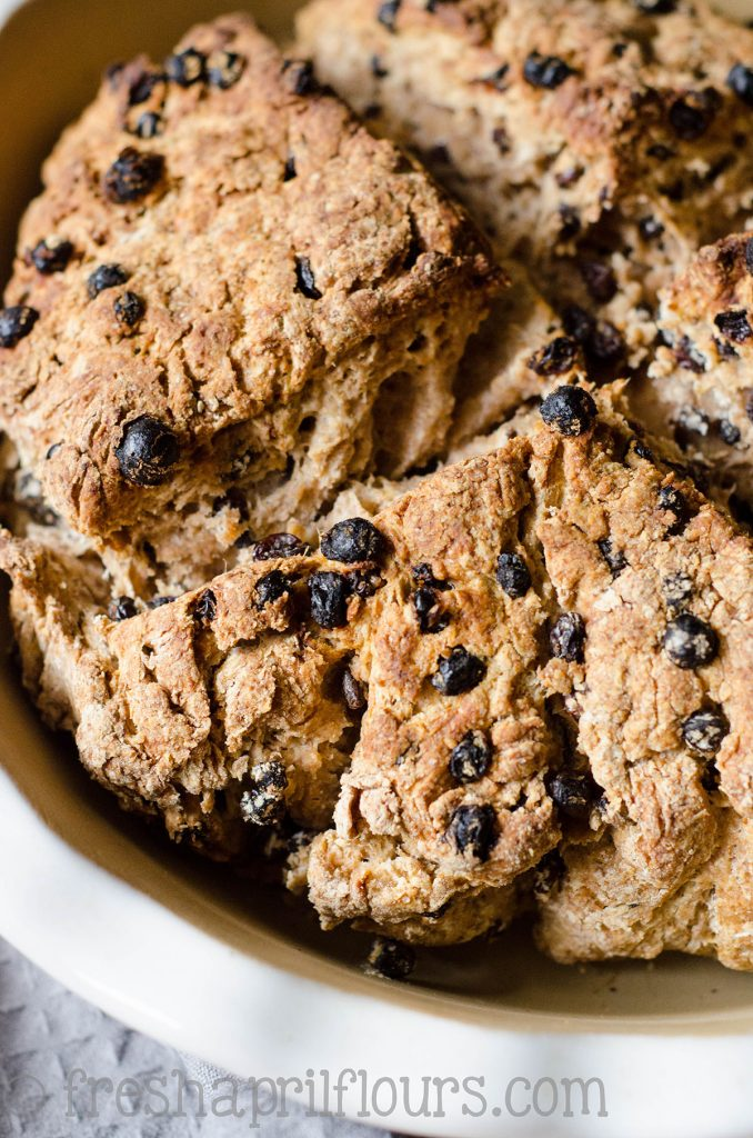 Irish Soda Bread: Dense, hearty, crunchy-on-the-outside bread with a faintly tangy interior studded with the slightly sweet yet tart bits of currants.