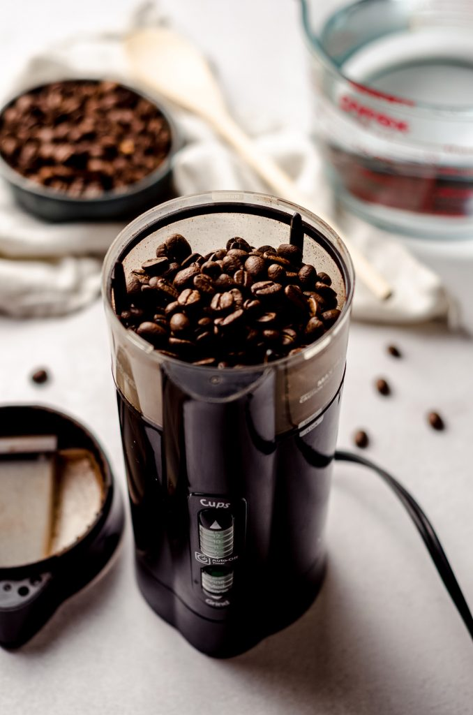 a coffee grinder full of coffee beans