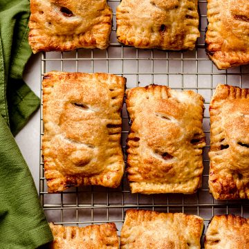 apple hand pies on a wire cooling rack