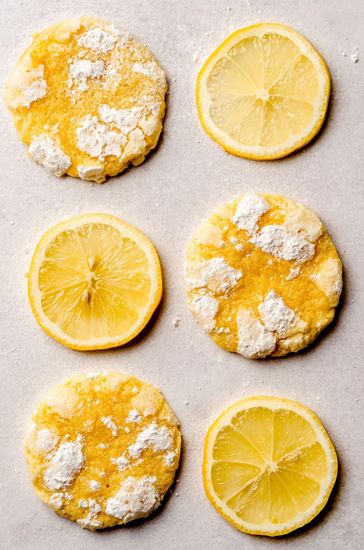lemon crinkle cookies alternating with slices of lemon