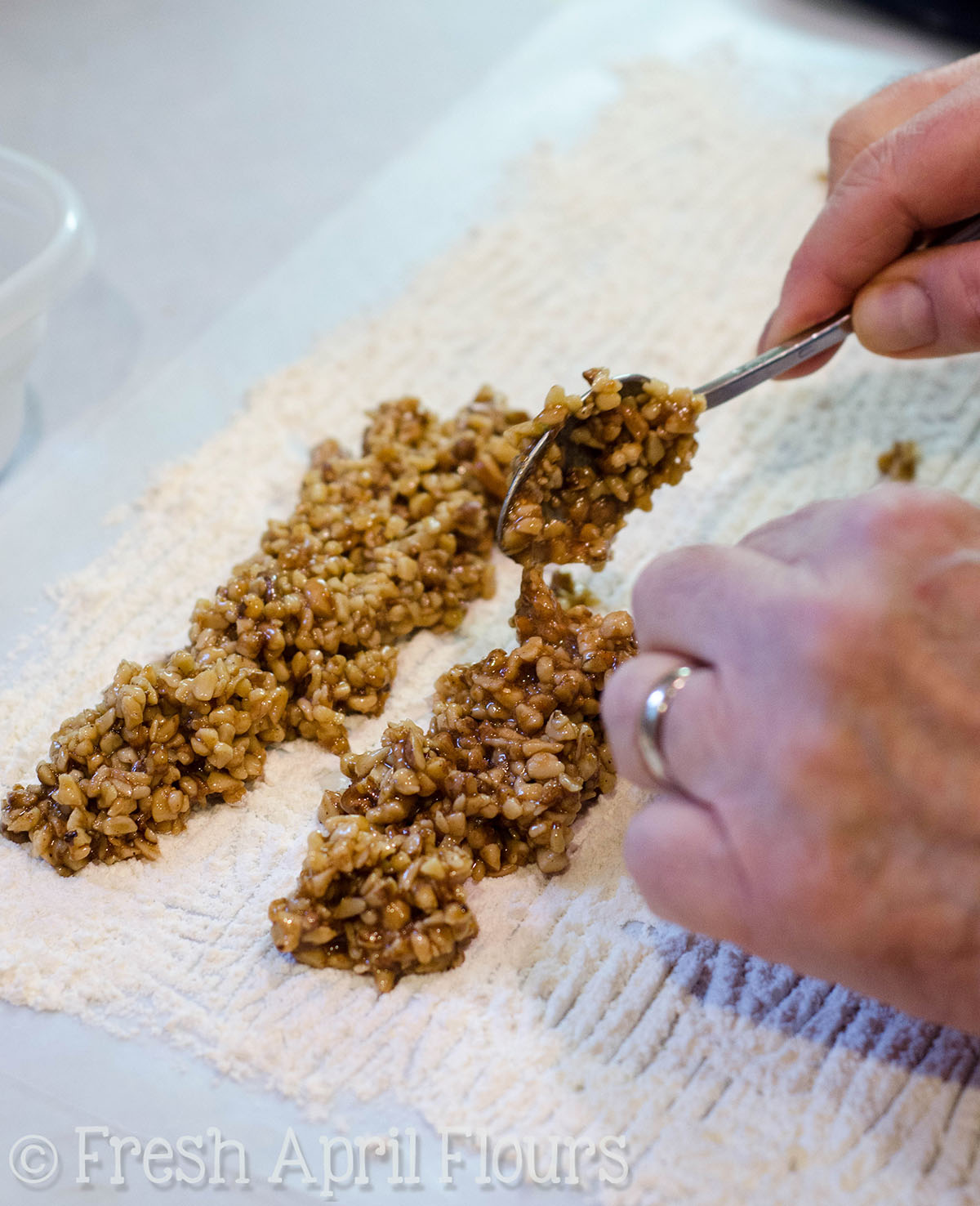 preparing filling for honey walnut cookie sticks
