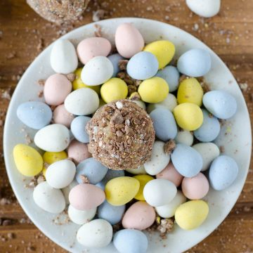Cadbury Egg Cookie Dough Bites: Eggless and safe-to-eat chocolate chip cookie dough balls filled and coated with crunchy pieces of Cadbury Mini Eggs. The perfect treat for Easter!