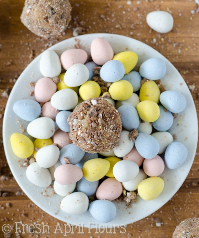 Chocolate Chip Mini Egg Cookie Dough Bites: Eggless and safe-to-eat chocolate chip cookie dough balls filled and coated with crunchy pieces of Cadbury Mini Eggs. The perfect treat for Easter!